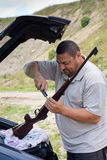 The shooter preparing rifle Stock Images