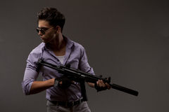 Shooter with Rifle. Handsome male shooter or contractor with automatic rifle Royalty Free Stock Photos