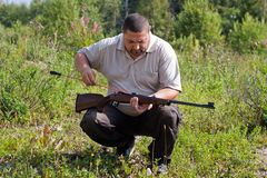 The shooter with rifle and ramrod Stock Image