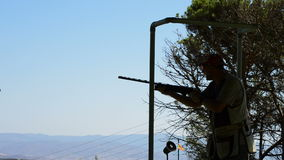 Shooter skeet shooting in a sport championship. Shooter skeet shooting in a sports championship