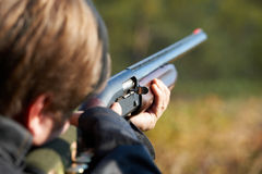 Shooter Takes Aim For Shot Royalty Free Stock Images