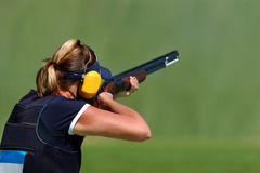 Shooting 01. A female trap shooter read to shoot a clay pigeon Royalty Free Stock Image