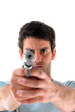 Shooting. Man pointing a weapon at the camera Stock Images