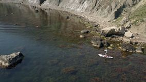 Shooting from air. Sea bay on quiet summer day. Fixed mirror water surface. Shooting from air. Delightful sea bay on quiet summer day. Fixed mirror water surface stock video footage