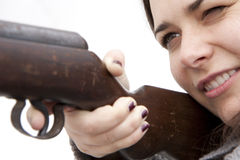 Shooting with air gun. Woman shooting with air gun - isolated Royalty Free Stock Images