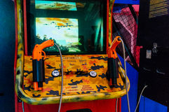 Shooting arcade game. Machine with guns in game room Royalty Free Stock Images