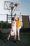 Shooting the basketball Stock Photography