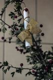 Romantic gift to his girlfriend bride. Declaration of love in the form of poems on a bouquet of torn hawthorn. stock photography