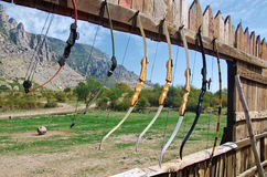 Shooting bows on a wooden wall Stock Photos