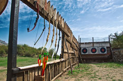 Shooting bows on a wooden wall Royalty Free Stock Photos