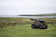 Shooting cannon Orkney coastline cliff landscape Royalty Free Stock Photos