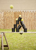 Shooting cans with balls Stock Photography