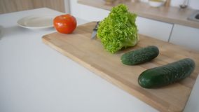 Shooting close-up of fresh vegetables on cutting board and kitch stock photo