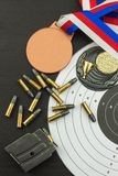 Shooting competition. Award winners. Biathlon victory. Ammunition and winners medals in biathlon. Stock Photos