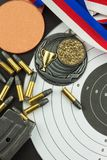 Shooting competition. Award winners. Biathlon victory. Ammunition and winners medals in biathlon. Stock Photography