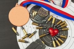 Shooting competition. Award winners. Biathlon victory. Ammunition and winners medals in biathlon. Stock Image