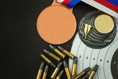 Shooting competition. Award winners. Biathlon victory. Ammunition and winners medals in biathlon. Royalty Free Stock Photography