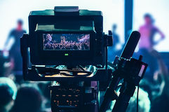 Shooting concert professional camera. View of the video camera v. Iewfinder Stock Image