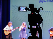 Shooting concert video. Control monitor. Blurred background, bokeh. Videography.  Royalty Free Stock Image