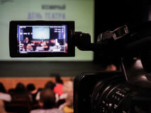 Shooting concert video. Control monitor. Blurred background, bokeh. Videography.  royalty free stock photography