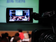 Shooting concert video. Control monitor. Blurred background, bokeh. Videography.  stock images