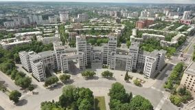 Shooting from a copter of the building in constructivism style near the park stock video