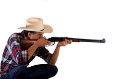 Shooting Cowboy. A cowboy shooting a rifle on a white background Royalty Free Stock Image
