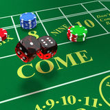 Shooting craps with bets on table. Craps dice rolls called any craps, hi-lo, boxcars, midnight with green felt table Royalty Free Stock Images