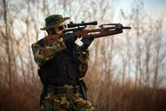 Shooting with crossbow. The military man is shooting with crossbow weapon outdoors Royalty Free Stock Photo