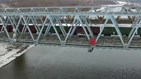 Movement of freight train through the railway bridge. Shooting with DJI Inspire x3 or OSMO x3 at winter 2016 stock video