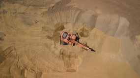 Aerial photo of excavator on sand. On the construction site top view. stock image