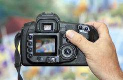 Shooting with DSLR Digital Camera. Back view of modern professional handheld DSLR Digital Camera Stock Photography