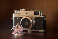 Shooting Flowers. Image of rangefinder film camera ready for flower macro shot Stock Photography