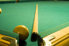 Shooting a game of poor or billiards Royalty Free Stock Photo