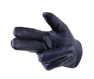 Shooting gesturing. A hand in black leather glove making a shooting gesturing, isolated on white background Royalty Free Stock Photos