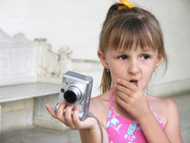 Shooting girl. Close-up little girl shooting with digital camera Stock Photo