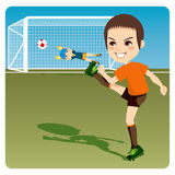 Shooting at goal. Boy kicking soccer ball to score a goal and win the competition Royalty Free Stock Photography