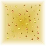 Shooting Gold. Fading gold background with red, rust and gold stars Royalty Free Stock Image