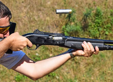 Shooting with a gun. At the shooting contest Stock Photo