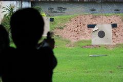Shooting gun Stock Photo