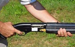 Shooting with a gun Stock Photo