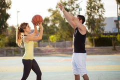 Shooting hoops with my girlfriend Stock Photos