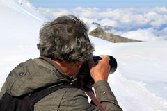 Shooting ice, snow and clouds of the Jungfraujoch stock photography