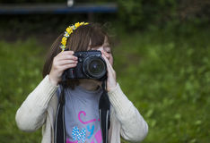 Shooting little girl Royalty Free Stock Images