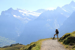 Shooting the magnificent view upon the Swiss Alps. Walking from the mount of Mannlichen to the Kleine Scheidegg in the Swiss mountains of the Bernese Oberland a Royalty Free Stock Photography