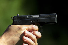 Shooting. Man practicing shooting with a gun royalty free stock photo