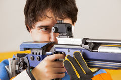 Shooting. Man training sport shooting with air rifle gun Stock Image