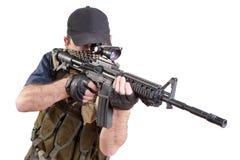 Shooting mercenary isolated Royalty Free Stock Photography