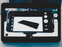 Shooting in shooting, mobile devices frame in frame close-up royalty free stock images