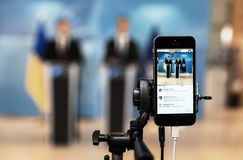 Shooting on a mobile phone. BRUSSELS, BELGIUM - Oct 20, 2016: Shooting on a mobile phone. Press Work during President of Ukraine Petro Poroshenko joint briefing Stock Images